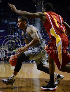 (Photo by Parker Robb | Collegian)  K-State forward Rodney McGruder, looking for an open teammate, dribbles past an Iowa State defender during the Wildcats' game against Iowa State February 9, 2013 at Bramlage Coliseum. The Wildcats avenged their earlier loss to the Cyclones in Ames with a 79-70 victory, and now remain the sole team in possession of first place in the Big XII.
