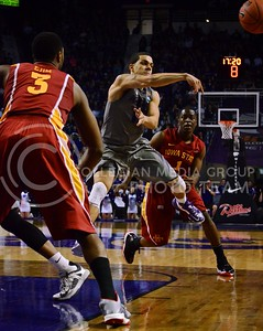 (Photo by Parker Robb | Collegian)  K-State guard Angel Rodriquez jump-passes the ball to a Wildcat teammate during the Wildcats' game against Iowa State February 9, 2013 at Bramlage Coliseum. The Wildcats avenged their earlier loss to the Cyclones in Ames with a 79-70 victory, and now remain the sole team in possession of first place in the Big XII.