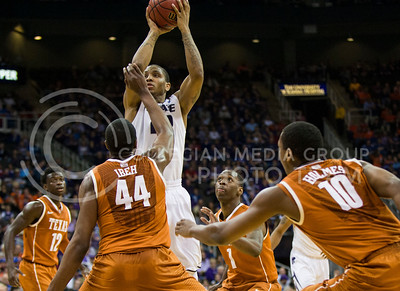 Senior guard Rodney Mcgruder pulls up for a shot over four Texas defenders on Thursday at the Sprint Center in the first round of the Big 12 Championship.  McGruder led the team with 24 points and grabbed 7 rebounds to help the Wildcats defeat Texas 66-49. (Photo by Emily DeShazer | Collegian)