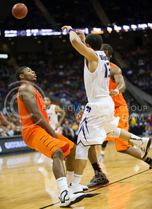 (Photo by Emily DeShazer | Collegian) Angel Rodriguez makes a pass as Marcus Smart falls back in the quarterfinals of the Big 12 Championship at the Sprint Center on March 15, 2013. Rodriguez was called for the foul.
