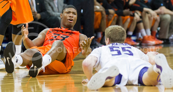 (Photo by Emily DeShazer | Collegian) Marcus Smart gestures to Will Spradling after both tripped and fell in the quarterfinals of the Big 12 Championship at the Sprint Center on March 15, 2013.