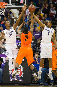 (Photo by Emily DeShazer | Collegian) Jordan Henriquez and Shane Southwell block Nash's shot in the quarterfinals of the Big 12 Championship at the Sprint Center on March 15, 2013.
