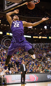 [Photo by Emily DeShazer | Collegian] Rodney McGruder dunks during the title game of the Big 12 Championship at the Sprint Center on March 16, 2013.
