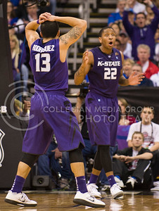 [Photo by Emily DeShazer | Collegian] Angel Rodriguez and Rodney McGruder react with disbelief after McGruder is called for his third personal foul during the title game of the Big 12 Championship at the Sprint Center on March 16, 2013.