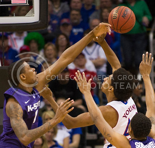 [Photo by Emily DeShazer | Collegian] Jordan Henriquez blocks Kevin Young's shot during the first half of the title game of the Big 12 Championship at the Sprint Center on March 16, 2013.