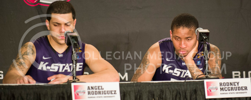 [Photo by Emily DeShazer | Collegian]<br /> Angel Rodriguez responds to a question as Rodney McGruder stares at the table during the press conference following the title game of the Big 12 Championship at the Sprint Center on March 16, 2013.