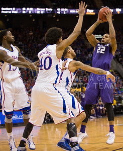 [Photo by Emily DeShazer | Collegian] Rodney McGruder shoots as he's surrounded by three Kansas defenders during the title game of the Big 12 Championship at the Sprint Center on March 16, 2013.