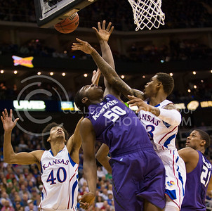 [Photo by Emily DeShazer | Collegian] Kevin Young, DJ Johnson and Ben Mclemore fight for a rebound during the title game of the Big 12 Championship at the Sprint Center on March 16, 2013.
