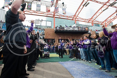 [Photo by Emily DeShazer | Collegian] Band members and K-State fans yell during the fight song at the pep rally before the title game of the Big 12 Championship on March 16, 2013.