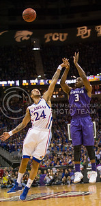 [Photo by Emily DeShazer   Collegian] Travis Relaford tries to block Martavious Irving's shot during the title game of the Big 12 Championship at the Sprint Center on March 16, 2013.