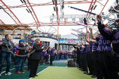[Photo by Emily DeShazer | Collegian] Fans and the pep band gather for a pep rally before the title game of the Big 12 Championship on March 16, 2013.