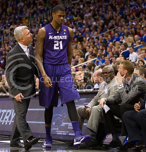 [Photo by Emily DeShazer | Collegian] Head coach Bruce Weber talks to Jordan Henriquez as he walks to a spot on the bench during the title game of the Big 12 Championship at the Sprint Center on March 16, 2013.