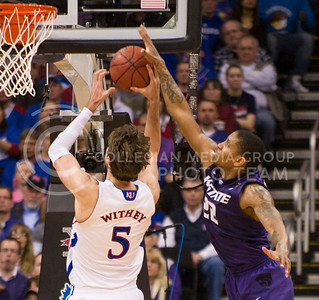 [Photo by Emily DeShazer   Collegian] Rodney McGruder blocks Jeff Whithey's shot during the title game of the Big 12 Championship at the Sprint Center on March 16, 2013. McGruder was then called for his third personal foul.