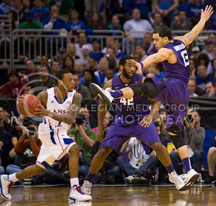 [Photo by Emily DeShazer   Collegian] Angel Rodriguez kicks through the air to try and block a pass during the title game of the Big 12 Championship at the Sprint Center on March 16, 2013.