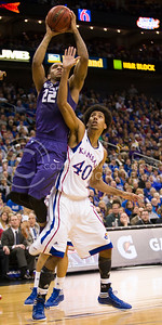 [Photo by Emily DeShazer | Collegian] Rodney McGruder takes aim from above Kevin Young during the title game of the Big 12 Championship at the Sprint Center on March 16, 2013.
