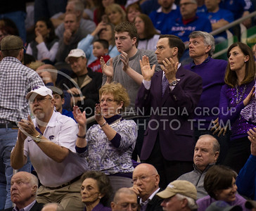 [Photo by Emily DeShazer   Collegian] Athletic director John Currie does the Wabash  during the title game of the Big 12 Championship at the Sprint Center on March 16, 2013.