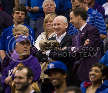 [Photo by Emily DeShazer   Collegian] Football head coach Bill Snyder and athletic director John Currie share a laugh before tipoff of the title game of the Big 12 Championship at the Sprint Center on March 16, 2013.