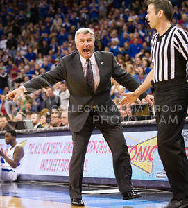 [Photo by Emily DeShazer | Collegian] Bruce Weber yells for the offense to move during the title game of the Big 12 Championship at the Sprint Center on March 16, 2013.