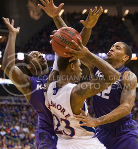 [Photo by Emily DeShazer | Collegian] DJ Johnson and Rodney McGruder try to keep Ben Mclemore from passing late in the second half during the title game of the Big 12 Championship at the Sprint Center on March 16, 2013.