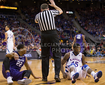 [Photo by Emily DeShazer | Collegian] Rodney McGruder and Elija Johnson sit on the floor after tripping over eachother during the title game of the Big 12 Championship at the Sprint Center on March 16, 2013.