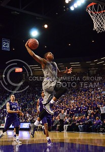 (Photo by Parker Robb | Collegian)  Going up for a dunk, K-State senior forward Rodney McGruder outruns the TCU defenders to the basket in his last game at Bramlage Coliseum on March 5. The Wildcats defeated the Horned Frogs 79-68, and remained in the race for the Big XII title with one game left.