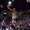 (Photo by Parker Robb | Collegian)<br /> <br /> Going up for a dunk, K-State senior forward Rodney McGruder outruns the TCU defenders to the basket in his last game at Bramlage Coliseum on March 5. The Wildcats defeated the Horned Frogs 79-68, and remained in the race for the Big XII title with one game left.