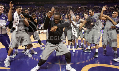 Senior guard Martavious Irving does a final dance in the center of his teammates on the floor of Bramlage Coliseum after the Cats game against TCU. This was the last home game for Irving as well as Rodney McGruder and Jordan Henriquez as well as four senior managers. The Cats beat the Horned Frogs 79-68.  (Photo by Evert Nelson | Collegian)