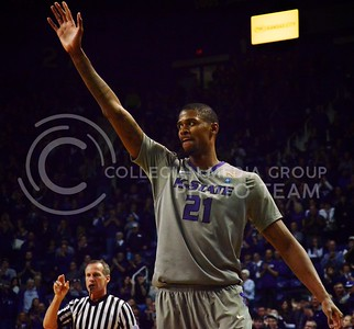 (Photo by Parker Robb | Collegian)  Waving to the crowd, K-State senior center Jordan Henriquez bids farewell to loyal K-State fans in the final minutes of his final game in Bramlage Coliseum March 5. The Wildcats defeated the Horned Frogs 79-68, and remained in the race for the Big XII title with one game left.