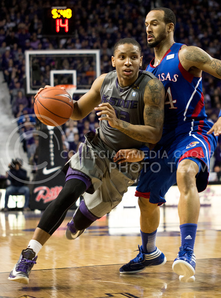 Senior guard Rodney McGruder drives past KU's Travis Releford in the Wildcats' 59-55 loss to the Jayhawks on January 22nd at Bramlage Coliseum. McGruder leads the team with 15.3 points per game. [Jacob Dean Wilson]