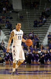 Sophomore guard Angel Rodriguez dribbles up the court during the Wildcat's Nov. 9th game against North Dakota in Bramlage Coliseum. Student attendance at home games is awarded by a points system that some abuse by scanning their tickets at the door and leaving early, resulting in a sparse student section. [Jacob Dean Wilson | Collegian]