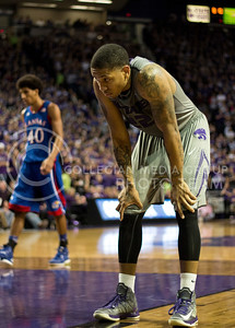 "[""Out of Reach""] Senior guard Rodney McGruder catches his breath during the Sunflower Showdown between K-State and KU on Tuesday in Bramlage Coliseum. McGruder has only celebrated a victory over Kansas once in eight tries, as the Wildcats eventually fell 55-59 in a tight game. Although McGruder was the Wildcats' second leading scorer, his 13 points came as a result of 4-for-12 field goal shooting and proved to be too little, too late in the Cats' first loss to a conference rival this season. [Jacob Dean Wilson]"