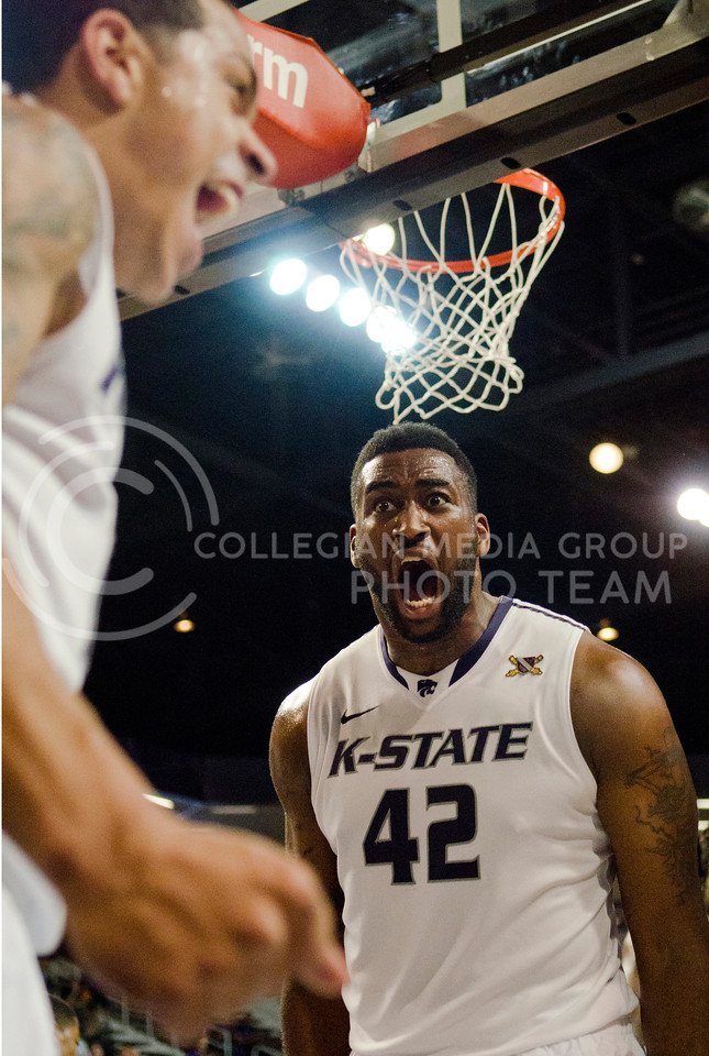 Kansas State sophomore guard Angel Rodriguez celebrates with sophomore forward Thomas Gipson (42) after scoring a basket while being fouled during the Wildcat's 85-51 exhibition win against Emporia State on November 4th in Bramlage Coliseum. Rodriguez ended the game with 10 points and three assists. [Jacob Dean Wilson | Collegian]