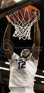 Junior guard Omari Lawrence dunks the ball during the Wildcat's 87-26 destruction of the Alabama-Huntsville Chargers during the NIT Season Tip-Off Midwest Regional Championship on November 13th in Bramlage Coliseum. After the win, the Wildcat advanced to the NIT Season Tip-Off semifinals in New York City. [Jacob Dean Wilson | Collegian]