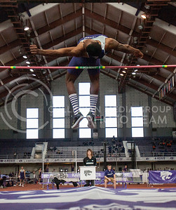 Erik Kynard, senior high jumper, soars over the bar at Ahearn Fieldhouse Saturday January 19. This jump of 7 foot, 6 inches at the Wildcat Invitational landed Kynard a new record for the event as well as the best indoor high-jump mark by a collegiate athlete in America as of now.   (Photo by Evert Nelson / Collegian)