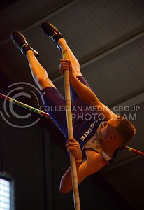 (Photo by Parker Robb | Collegian)  K-State pole vaulter Devin Dick pushes himself over the pole-vault bar at the K-State Open Track and Field meet February 16 at Ahearn Fieldhouse.