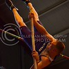 (Photo by Parker Robb | Collegian)<br /> <br /> K-State pole vaulter Devin Dick pushes himself over the pole-vault bar at the K-State Open Track and Field meet February 16 at Ahearn Fieldhouse.