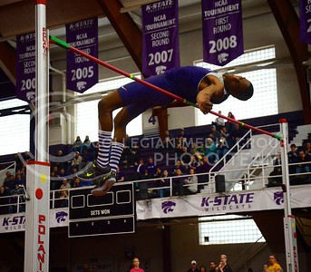 (Photo by Parker Robb | Collegian)  K-State high jumper and Olympic silver-medalist Erik Kynard soars over the high-jump bar at the K-State Open Track and Field meet February 16 at Ahearn Fieldhouse. Kynard tied his personal and university record of 2.33m/7ft7.75in in the high jump, moving him to first place in the NCAA, but failed in three attempts to set a new collegiate record of 2.38m/7ft9.75in.