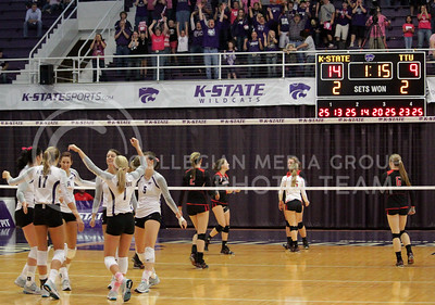 The Wildcat's celebrate after winning their match point in a thrilling 5-set victory over the visiting Texas Tech Red Raiders on october 20th in Ahearn Field House. [Jacob Dean Wilson]