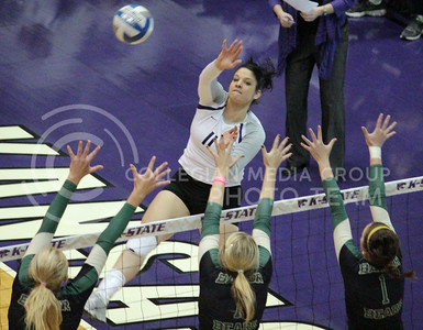 Junior outside hitter Lilla Porubek spikes the ball against a trio of Baylor defenders during the Wildcats' 3-1 victory against the visiting Bears on October 27th in Ahearn Field House. [Jacob Dean Wilson]