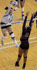 Junior outside hitter Lilla Porubek spikes the ball over Texas Tech middle blocker Mikia Mills during the Wildcat's 3-2 victory over the visiting Red Raiders on October 20th in Ahearn Field House. [Jacob Dean Wilson]