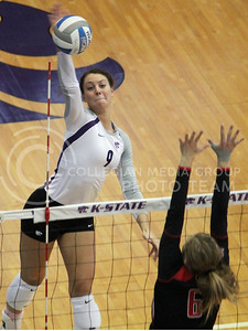 Senior middle blocker Alex Muff spikes the ball against a Texas Tech defender during the Wildcat's 3-2 victory over the visiting Red Raiders on October 20th in Ahearn Field House. [Jacob Dean Wilson]