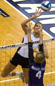 Junior middle blocker Kaitlynn Pelger pushes the ball over opposing Texas Christian senior middle blocker Emily Kirby during the Wildcat's three set sweep against the visiting Horned Frogs on November 10th in Ahearn Field House. Pelger finished the match with 15 kills. [Jacob Dean Wilson | Collegian]