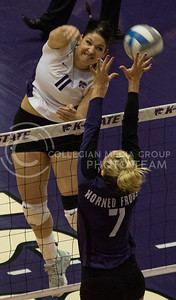 Junior outside hitter Lilla Porubek spikes the ball over opposing Texas Christian redshirt senior setter Megan Munce during the Wildcat's three set sweep against the visiting Horned Frogs on November 10th in Ahearn Field House. Porubek finished the contest with seven kills. [Jacob Dean Wilson | Collegian]