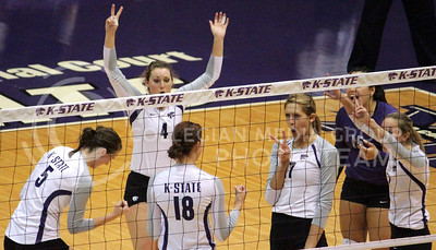 The K-State Volleyball team celebrates after winning a point in the closely contested second set of their November 7th match against the visiting KU Jayhawks in Ahearn Field House. The Wildcats eventually lost the set 26-28 and the match 3-1. [Jacob Dean Wilson]