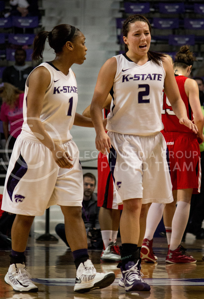 Senior guard Brittany Chambers is comforted by sophomore guard Haley Texada after Chambers is poked in the eye during the sec on half of the Wildcats' 54-46 loss to the visiting Utah Utes on April 3, 2013 in Bramlage Coliseum during the Semifinals of the Women's National Invitation Tournament (WNIT). [Jacob Dean Wilson | Collegian]