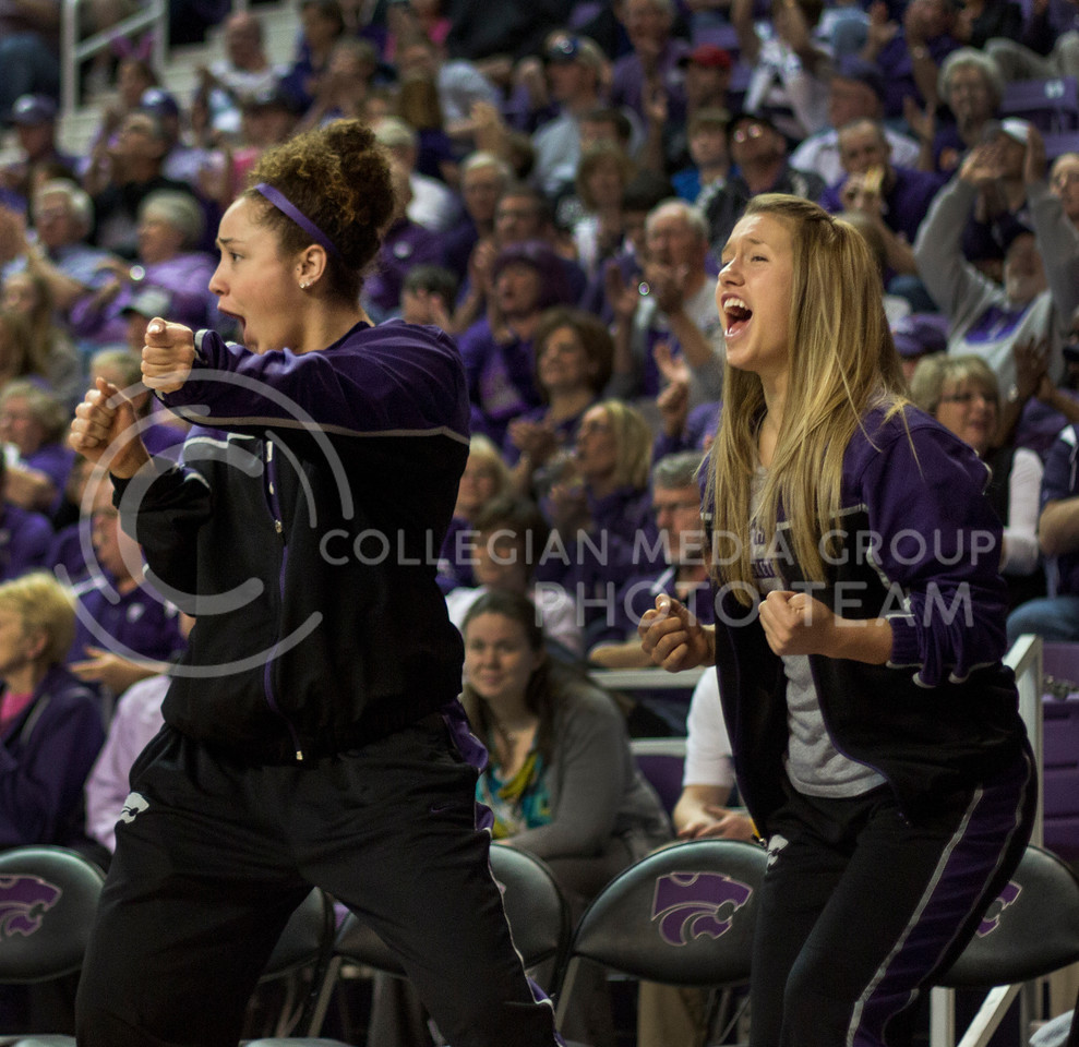 Junior forward Katya Leick and freshman guard Kelly Thomson celebrate after a K-State three pointer during the Wildcats' 66-48 win over the visiting Illinois Fighting Illini on March 30, 2013 in Bramlage Coliseum during the Quarterfinals of the Women's National Invitation Tournament (WNIT). With the victory, the Wildcats' advance to the WNIT Semifinals and are set to face Utah on April 3rd in Bramlage Coliseum. [Jacob Dean Wilson | Collegian]