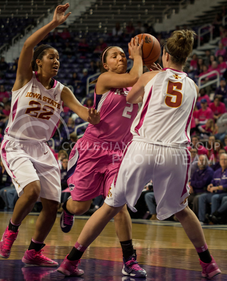 Senior guard Brittany Chambers drives through the line past Iowa State sophomore guard Brynn Williamson and junior forward Brynn Williamson during the Wildcats' 50-69 loss to the Cyclones on February 23rd in Bramlage Coliseum. [Jacob Dean Wilson | Collegian]