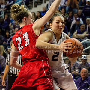 Senior guard Brittany Chambers fights past Illinois State senior guard Jamie Russell during the Wildcats' 57-48 victory over the opposing Redbird's during the second round of the Women's Nation Invitation Tournament (WNIT) on March 25th, 2013, in Bramlage Coliseum. With the victory, K-State advanced to play Ball State in the third round of the WNIT on March 28th in Bramlage Coliseum. Chambers finished the contest with 28 points. [Jacob Dean Wilson   Collegian]