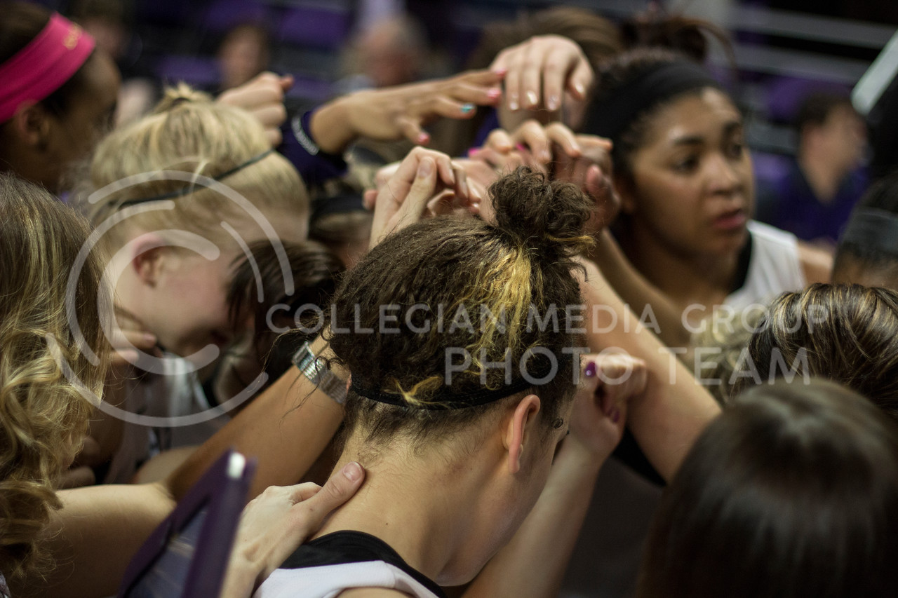 Members of the K-State Women's Basketball team huddle up following their emotional 60-48 victory over the visiting Ball State Cardinals on March 28, 2013 in Bramlage Coliseum during the third round of the Women's National Invitation Tournament (WNIT). With the victory, the Wildcats' advance to the WNIT Quarterfinals and are set to face Illinois on March 30, 2013 in Bramlage Coliseum. [Jacob Dean Wilson | Collegian]