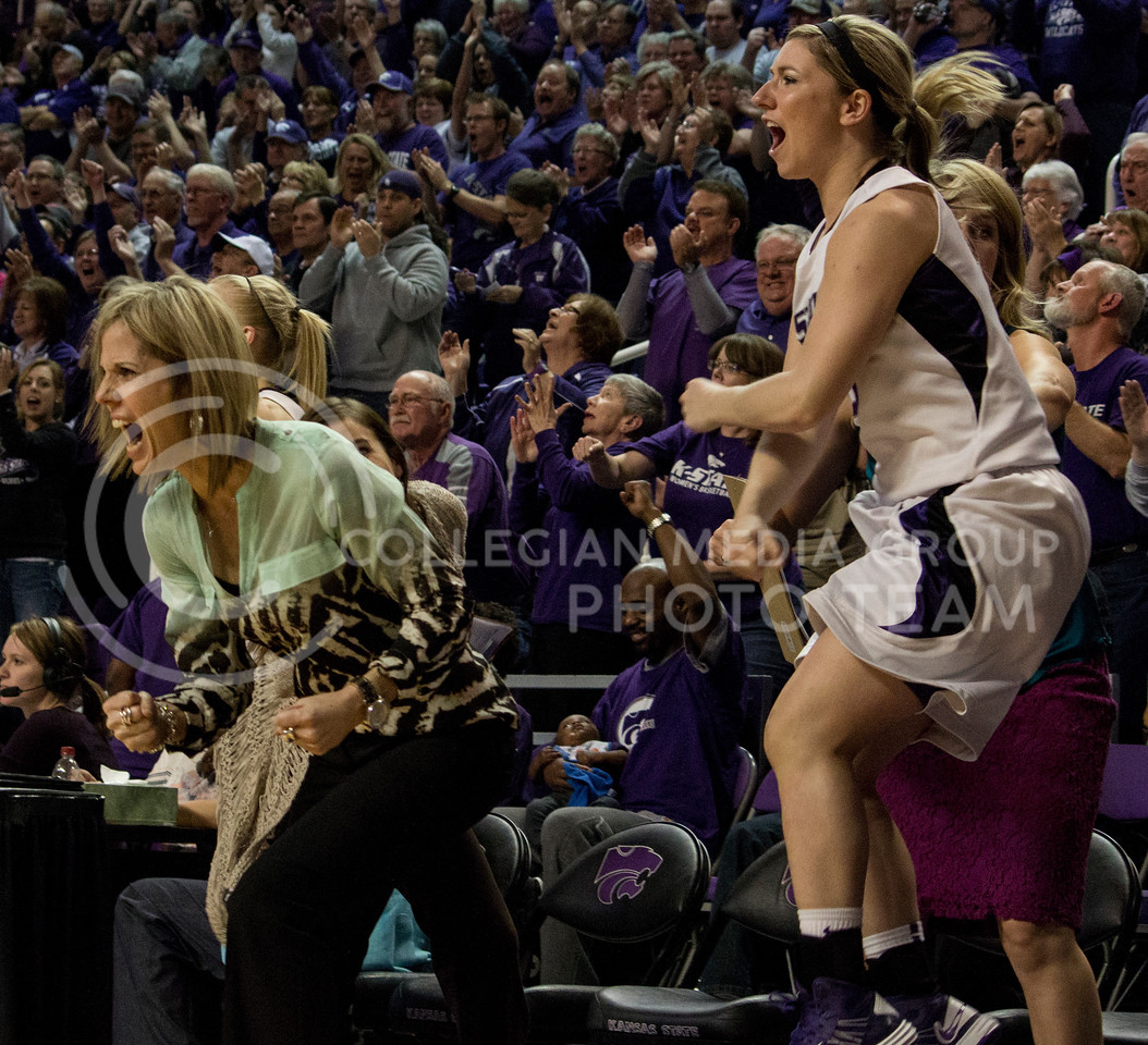 The Wildcat bench and fans erupt during the second half of the Wildcats' 54-46 loss to the visiting Utah Utes on April 3, 2013 in Bramlage Coliseum during the Semifinals of the Women's National Invitation Tournament (WNIT). K-State came back from being down 14 points at most and were able to force the game into overtime, where they were eventually defeated. [Jacob Dean Wilson | Collegian]